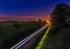 Train trails (Bajo Rogan) Tags: uk railroad travel blue light sunset sky london nature night train landscape dawn coach long exposure traffic time outdoor transport swindon rail railway business journey rush hour transportation locomotive economy whitehorsehill