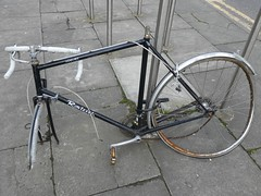 Dead bike on Oxford Road (stillunusual) Tags: uk england urban bike bicycle manchester cycling urbandecay streetphotography cycle mcr urbanscenery 2016 deadbike manchesterstreetphotography