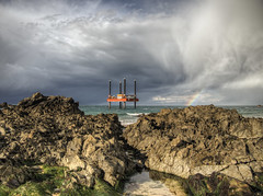 Rig and Rainbow  on Alderney (neilalderney123) Tags: cloud storm beach water landscape bay poetry rig alderney badpoetry lymerick corbletts 2016neilhoward 2016neilhoward