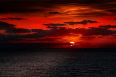 South Texas Sunrise (Danny Shrode) Tags: ocean red sea sky cloud beach water clouds sunrise landscape dawn seaside outdoor shore serene