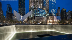 9/11 Memorial and Museum (DSC04254) (Michael.Lee.Pics.NYC) Tags: newyork museum architecture night twilight cityscape sony worldtradecenter wtc bluehour oculus santiagocalatrava 911memorial transportationhub a7rm2 zeissloxia21mmf28