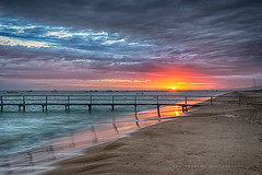 Sunrise (Rob Reaburn Photography) Tags: ocean beach clouds sunrise reflections bay pier sand waves jetty tide redsky sorrento morningtonpeninsula mtmartha