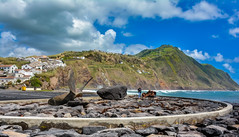 Azores (free3yourmind) Tags: sea seascape mountains clouds island town rocks day cloudy stones mole propeller azores saomiguel