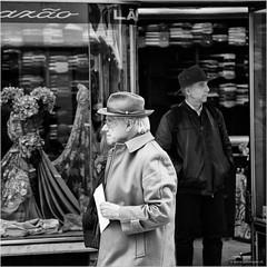 A walk to the postbox (John Riper) Tags: street old bw woman white man black portugal monochrome shop canon john walking square photography mono waiting zwartwit lisboa lisbon candid hats shirts letter l gentleman gentlemen 6d 24105 straatfotografie riper johnriper