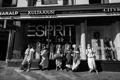 Street scenes (HKI DRFTR) Tags: people urban blackandwhite helsinki europe religion group streetphotography shoppingmall krishna consumerism socialcommentary socialdocumentary munks