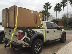 Items Loaded On The Truck Bed Cover Of A Ford F150 Raptor (DiamondBack Truck Covers) Tags: ford se aluminum closed c f150 driveway raptor diamondback diamondplate whitetruck ratchetstrap ff09 tonneaucover truckbedcover cargoontop passengersidetaillightview ruggedblack