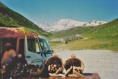 Pyrenees Sausage Stall (brightondj - getting the most from a cheap compact) Tags: snow france mountains bike shop basket sausage stall scan cycle scanned sausages van bikeride pyrenees salami olympusxa pyrnesorientales cycletouring