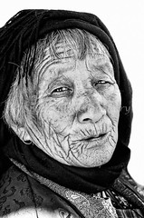 Bhutanese Old Lady in prayer dress (Shutter Shooter) Tags: old travel red portrait woman white tourism senior lady hair tour dress adult bhutan buddha buddhist praying buddhism headshot mature short cropped local aged thimpu devotee wrinkled thimphu 2013