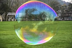 The world in a bubble (Tony Shertila) Tags: water europe colours britain outdoor dream floating bubbles refraction iridescent betwsycoed sheen wals shorttime efemeral