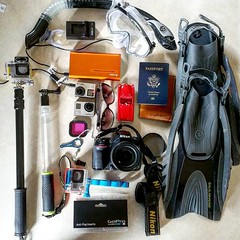 T is for Travel Essentials (AngelBeil) Tags: sunglasses square snorkeling masks squareformat accessories poles whatsinyourbag passport knuckles fins redcar gopro iphoneography jackery instagramapp uploaded:by=instagram lochobag reallyaredcarwasinthere