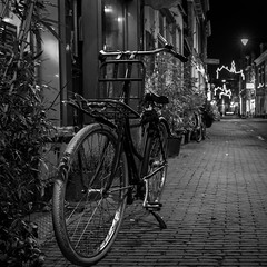 The Transporter (McQuaide Photography) Tags: street old city longexposure nightphotography winter light urban blackandwhite bw holland haarlem netherlands monochrome dutch bike bicycle night photoshop outside mono licht blackwhite lowlight europe dof nacht outdoor sony tripod transport nederland 11 cobbled depthoffield cobblestone fullframe alpha oud squarecrop stad fiets manfrotto noordholland lightroom straat northholland a7ii stadsfiets mirrorless kleinehoutstraat mcquaidephotography ilce7m2