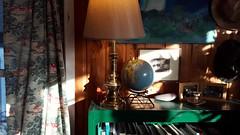 Cabin Corner (Mamluke) Tags: verde green art home lamp hat minnesota rock corner vintage painting frames globe cabin groen teal interior hats books vert shelf frame curtains grn shelving brass candleholder paneling paneled mamluke