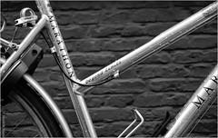 Framed (Hindrik S) Tags: blackandwhite detail monochrome bike bicycle wheel metal 35mm grey iso100 noiretblanc zwartwit lock sony rad part frame 1750 slot tamron tones f28 metaal fiets grijs 1125 a57 onderdeel tamron1750 sonyalpha tamronspaf1750mmf28xrdiiildasphericalif tinten fyts sonyphotographing swartwyt slta57 57