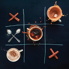Coffee wins (Dina Belenko) Tags: food motion black game coffee dark advertising dessert fun chalk milk play drink sweet sale drawing top cinnamon creative fromabove sugar splash chalkboard simple minimalist coffeebreak clever khabarovsk tictactoe noughtsandcrosses highshutterspeed