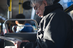 Newspaper (dtanist) Tags: new york city nyc newyorkcity newyork bus brooklyn canon 50mm reading newspaper sony read mta commuter heights rider a7 fd dyker busrider b8