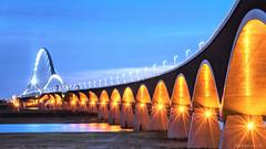 De Oversteek (dejongbram) Tags: longexposure bridge blue sky orange holland nijmegen nikon le bluehour lent gelderland oversteek deoversteek