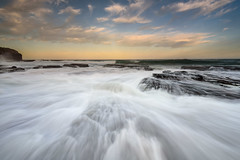 Flowing Lines (Rodney Campbell) Tags: ocean sky water clouds rocks au australia newsouthwales cpl wombarra gnd09