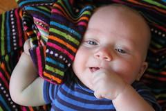 Blanket and thumb (quinn.anya) Tags: baby smile paul stripes blanket thumb