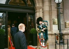 op - bagpipes player (johnnytakespictures) Tags: city musician music film pen hotel scotland lomo lomography edinburgh kilt traditional guard entrance olympus player analogue procession bagpipes halfframe entry tartan robes regala ee3 lomographycn400