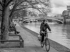 Cycling along the River Ouse towpath in York (steve.gombocz) Tags: york blackandwhite cycling noiretblanc olympus riverouse negroyblanco bwphotos olympuscamera riverscene schwartzundweiss mzuikodigital25mmf18lens olympusomdm5mark2