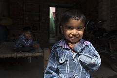 Brothers (Ravikanth K) Tags: light boy shadow portrait people india cute boys smile festival shirt kids kid brothers shy same innocence balance local holi checks uttarpradesh 500px