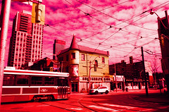 Nothing But Pink Skies (Georgie_grrl) Tags: pink light sky toronto ontario lines sign architecture clouds buildings crossprocessed ttc tracks wires storefront colourful streetcar queenandchurch rikenon12828mm velvia100slidefilm shawarmasking sunshinepentaxk1000