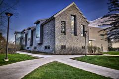 Academic Commons (sidewalk view), 2016.04.24 (Aaron Glenn Campbell) Tags: building architecture rural reflections campus evening spring pennsylvania sony country sigma lehman hdr nepa luzernecounty backmountain mirrorless a6000 psuwb a6k pennstatewilkesbarre emount macphun 19mmf28exdn sonyalpha6000 ilce6000 3ev aurorahdrpro