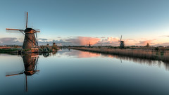 Dawn at Kinderdijk (m0nt2) Tags: sky sunlight holland reflection nature water netherlands windmill clouds landscape dawn duck waterfront bluehour wrinkles kinderdijk tokina1224mmf4 d300s nederwaardno5