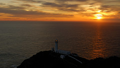 Sunset over South Stack (dinkysi) Tags: sunset sea lighthouse wales anglesey southstack
