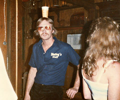 Hutley's. August 1983. Quite the balancing act :-) (BruceLorenz) Tags: street new york ny st bar island pub long main tavern 1984 eighties 1980s 501 islip theeighties hutleys
