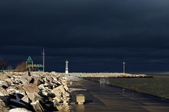 Lake Michigan Storm Clouds (mraarondouglas) Tags: camera blue winter light sunset sun lighthouse lake snow storm wet water rock wisconsin clouds marina canon dark observation point photography rebel harbor pier photo rocks waves image michigan il deck photograph milwaukee t5 rough icy reef effect wi racine reefpoint 1200d