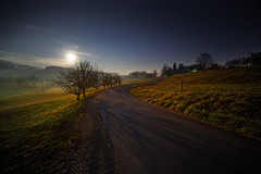 On a moonlit night (marko.erman) Tags: road trees light shadow panorama moon mist beautiful misty night stars landscape countryside sony calm moonlit slovenia moonrise silence astrophotography serene marjeprijelah