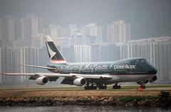 Cathay Pacific 747 'B-HIB' (Longreach - Jonathan McDonnell) Tags: hongkong scan 1997 boeing 1990s 747 hongkongisland kaitak cathaypacific 747200 logojet nikoncoolscanved scanfromaslide vhhh bhib 747267 thespiritofhongkong97