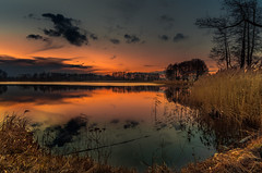 The tranquility of dusk 2 (piotrekfil) Tags: trees winter sunset sky lake nature water clouds reflections landscape twilight pentax dusk poland waterscape piotrfil