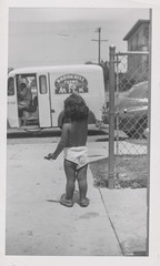 Naked child waits for the milk truck (simpleinsomnia) Tags: old white black monochrome truck vintage nude found blackwhite milk kid child underwear antique african snapshot photograph american delivery africanamerican vernacular foundphotograph milktruck