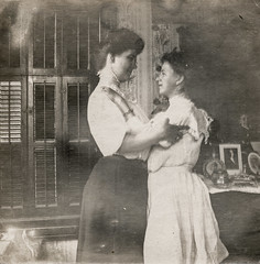 Two women embracing (simpleinsomnia) Tags: old woman white black reflection monochrome vintage found mirror blackwhite antique interior snapshot photograph vernacular inside affectionate foundphotograph embracing