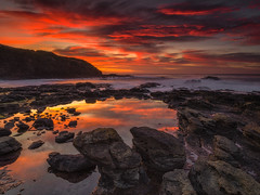 Flinders Blowhole in Scarlet (Bjorn Baklien) Tags: ocean red seascape reflection water sunrise scarlet landscape dawn rocks australia victoria cliffs flinders bluff pentax645z