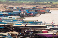 The boats lined up for our trip on the Tonl Sap (amanda & allan) Tags: cambodia tonlsap