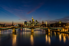 Mainhattan blue hour (hjuengst) Tags: longexposure bridge blue reflection skyline skyscraper germany streetlight hessen frankfurt wideangle bluesky bluehour brcke spiegelung lichter sachsenhausen langzeitbelichtung reflektionen blauestunde weitwinkel flserbrcke nikond7000