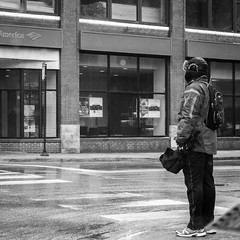 Waiting for permission (dharder9475) Tags: street winter blackandwhite bw storm man water rain weather square waiting wind candid gray overcast dreary intersection crosswalk 2015 lawrenceavenue privpublic