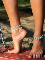 Aloha's feet on a swing (sunnystreets) Tags: feet female foot toes arch purple legs polish jewellery rings nails barefoot pedicure anklets