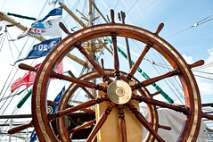 Steering wheel (pilgrim.ru) Tags: travel cruise summer boat wooden sailing control wind yacht sunny flags parade adventure equipment direction round regatta nautical activity navigation steeringwheel yachting