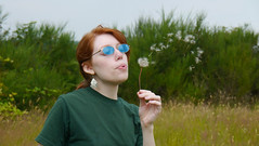 Sowing Seeds (swong95765) Tags: plant flower field sunglasses female weed wind blow seeds redhead