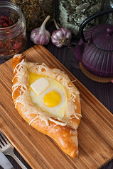 Acharuli Khachapuri. Georgian bread cheese and egg (Dariia_Belkina) Tags: wood food white kitchen rose yellow cheese breakfast dinner dark georgia pie crust bread table lunch cuisine wooden picnic tea traditional egg cottage salt knife fork fresh sugar arabic crispy kettle homemade spices butter mozarella bakery meal oil pastry garlic georgian flour yeast fried pitcher rosehip yolk baked khachapuri suluguni