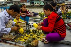 Preparing Pineapples to eat (firstfire53) Tags: river asia vietnam mekongdelta