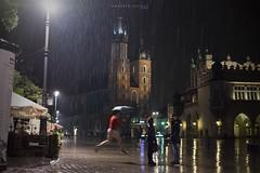 Falso d'autore... Under the rain (umberto.ruvolo) Tags: rain night atmosphere copia luci piazza pioggia bresson cracovia ombrello autore emozione
