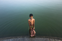 Innocence.. (nshrishikesh) Tags: morning light boy portrait india distortion water canon photography flickr photographer candid explorer roots wideangle explore photowalk layer layers 1855 chennai incredible roi 600d incredibleindia thiruneermalai canon600d rootsofindia 121clicks