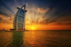 (waluntain) Tags: ocean city light sunset sea sky sun sunlight reflection fall beach nature water beautiful beauty set skyline night skyscraper sunrise reflections landscape photography boat al high colorado dubai cityscape view skyscrapers outdoor background cityscapes skylines places arab burjalarab views definition beaches highdefinition backgrounds resolution hd oceans rise breathtaking burj