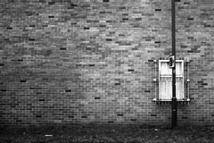 Post and window (Apionid) Tags: brick film window monochrome wall rollei negativespace lamppost obstruction nikonfm2 townplanning obtuse day31366 retro400s 366the2016edition 3662016 31jan16