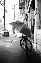 He... (HARU1231) Tags: city bw film bicycle pentax candid snap streetphoto mesuper